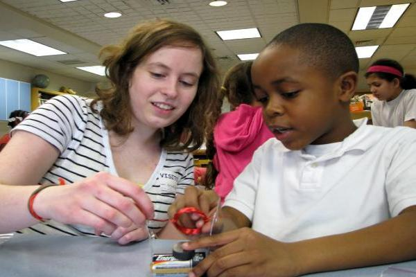 Lehigh graduate student assists a third-grade student in the construction of an electric motor