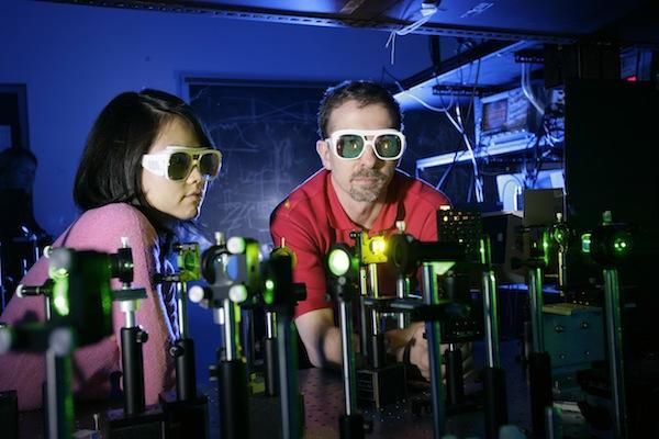 Professor Biaggio works with a graduate student in one of his laser labs